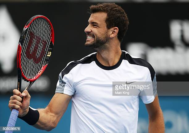 Grigor Dimitrov of Bulgaria celebrates winning match point in his quarter final match against Alexandr Dolgopolov of Ukraine during day six of the...