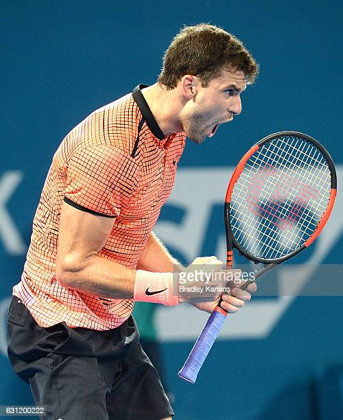Grigor Dimitrov of Bulgaria celebrates winning the first set against Kei Nishikori of Japan during the Men's Final on day eight of the 2017 Brisbane...
