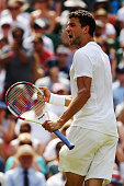 Grigor Dimitrov of Bulgaria celebrates winning the second set during his Gentlemen's Singles quarterfinal match against Andy Murray of Great Britain...