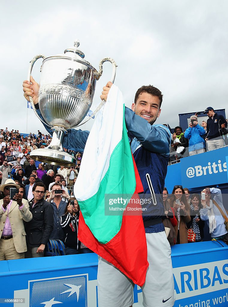<a gi-track='captionPersonalityLinkClicked' href=/galleries/search?phrase=Grigor+Dimitrov&family=editorial&specificpeople=4332557 ng-click='$event.stopPropagation()'>Grigor Dimitrov</a> of Bulgaria celebrates with the winners trophy after defeating Feliciano Lopez of Spain during their Men's Singles Final on day seven of the Aegon Championships at Queens Club on June 15, 2014 in London, England.