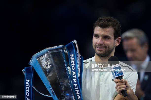 Grigor Dimitrov of Bulgaria celebrates with the winners trophy after his victory against David Goffin of Belgium in the Mens Final today Dimitrov def...
