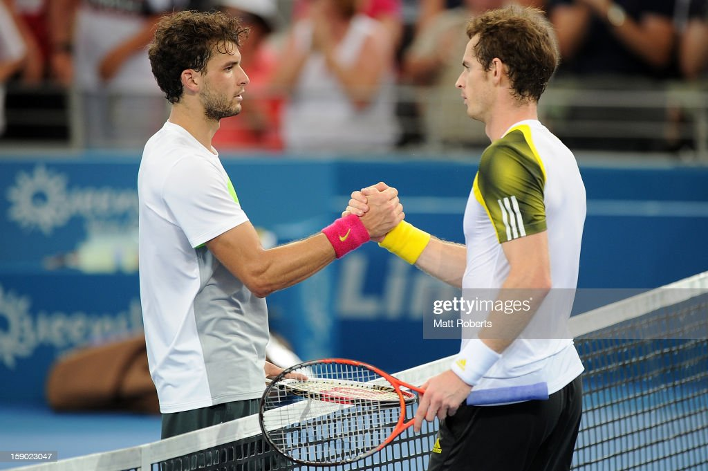 Grigor Dimitrov of Bulgaria congratulates Andy Murray of Great Britain after their final match on day eight of the Brisbane International at Pat Rafter Arena on January 6, 2013 in Brisbane, Australia.