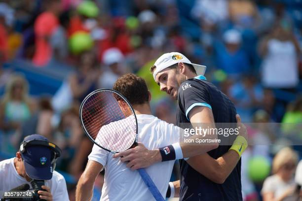 Grigor Dimitrov of Bulgaria congratulates John Isner of the United States after winning his semifinal match in the Western Southern Open at the...