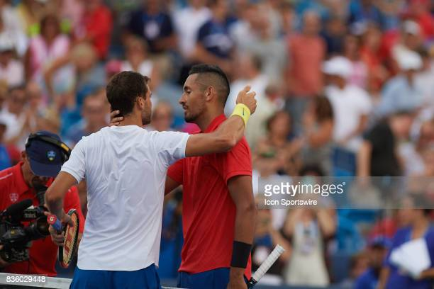 Grigor Dimitrov of Bulgaria congratulates Nick Kyrgios of Australia after winning the men's finals in the Western Southern Open at the Lindner Family...