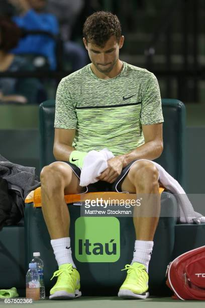 Grigor Dimitrov of Bulgaria cools down between points while playing Guido Pella of Argentina during the Miami Open at the Crandon Park Tennis Center...
