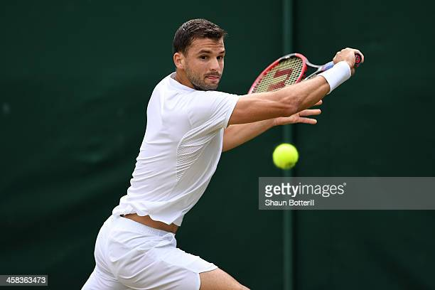 Grigor Dimitrov of Bulgaria during the plays a backhand against Steve Johnson of The United States on day six of the Wimbledon Lawn Tennis...