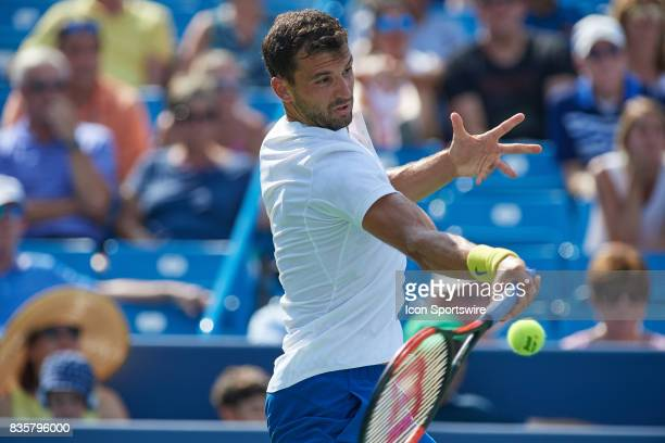 Grigor Dimitrov of Bulgaria hits a forehand during his semifinal match against John Isner of the United States in the Western Southern Open at the...
