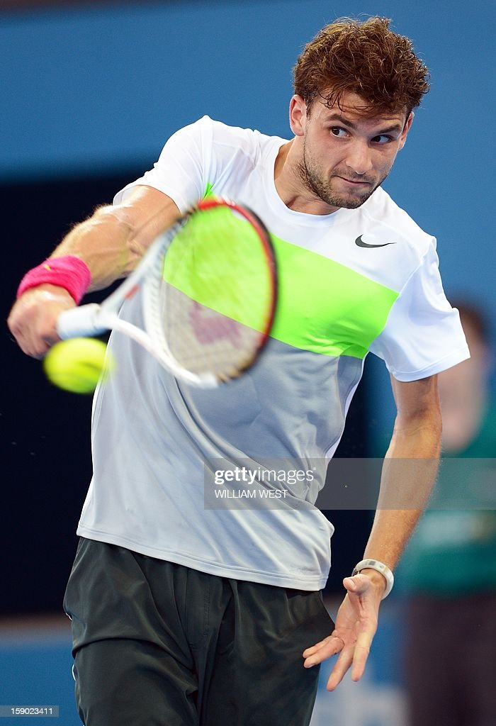 Grigor Dimitrov of Bulgaria hits a forehand return during his loss to Andy Murray of Britain in the final of the Brisbane International tennis tournament on January 6, 2013. AFP PHOTO/William WEST USE