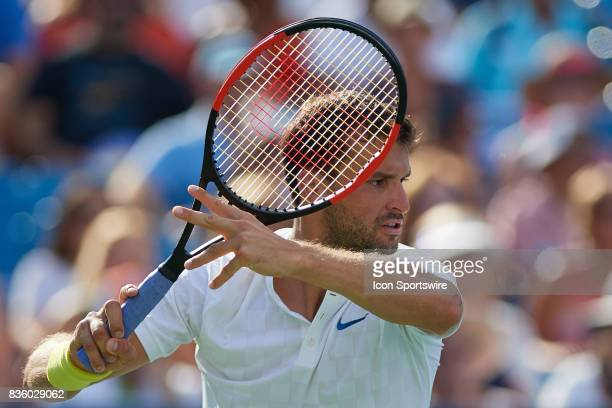 Grigor Dimitrov of Bulgaria hits a forehand to Nick Kyrgios of Australia during the men's finals in the Western Southern Open at the Lindner Family...
