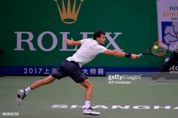 Grigor Dimitrov of Bulgaria hits a return against Rafael Nadal of Spain during their men's singles quarterfinal match at the Shanghai Masters tennis...