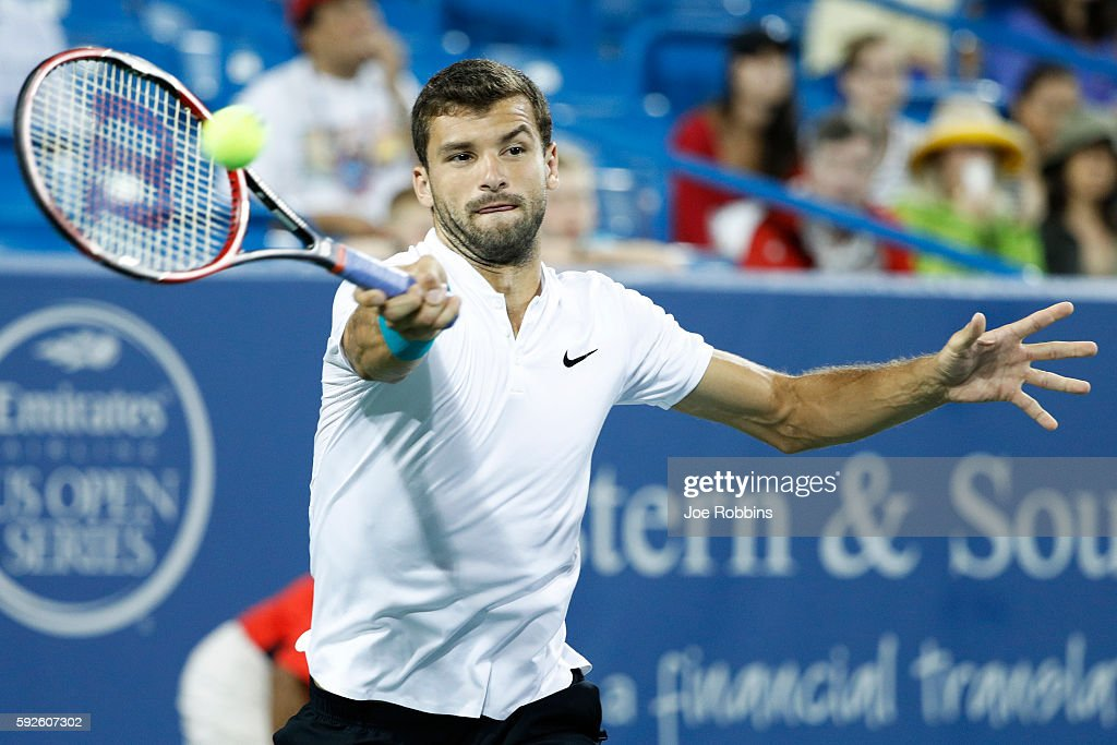 Grigor Dimitrov of Bulgaria hits a return to Marin Cilic of Croatia during a semifinal match on Day 8 of the Western & Southern Open at the Lindner Family Tennis Center on August 20, 2016 in Mason, Ohio.