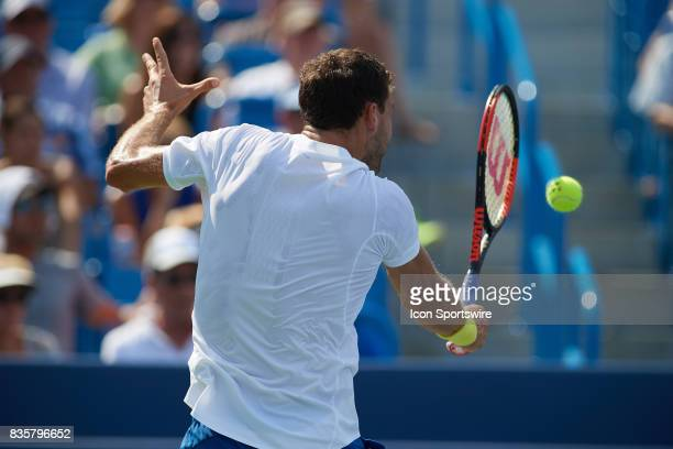 Grigor Dimitrov of Bulgaria hits a slice during his semifinal match against John Isner of the United States in the Western Southern Open at the...