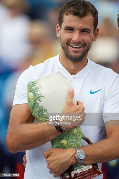 Grigor Dimitrov of Bulgaria holds the Rookwood Cup after winning the match against Nick Kyrgios of Australia during the men's finals in the Western...