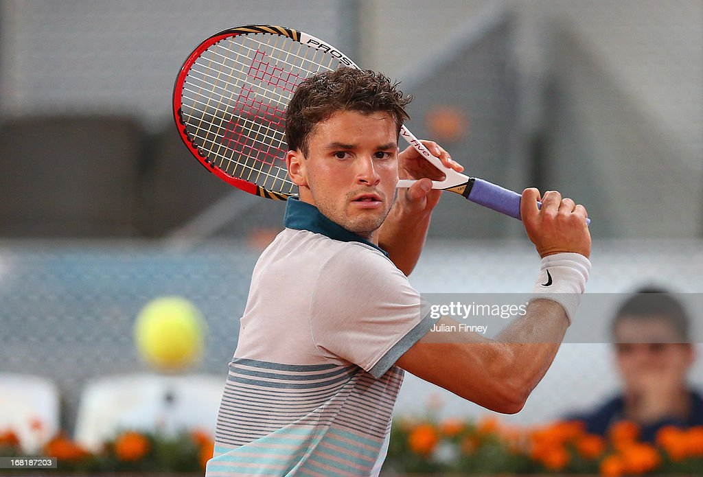 <a gi-track='captionPersonalityLinkClicked' href=/galleries/search?phrase=Grigor+Dimitrov&family=editorial&specificpeople=4332557 ng-click='$event.stopPropagation()'>Grigor Dimitrov</a> of Bulgaria in action against Javier Marti of Spain during day three of the Mutua Madrid Open tennis tournament at the Caja Magica on May 6, 2013 in Madrid, Spain.