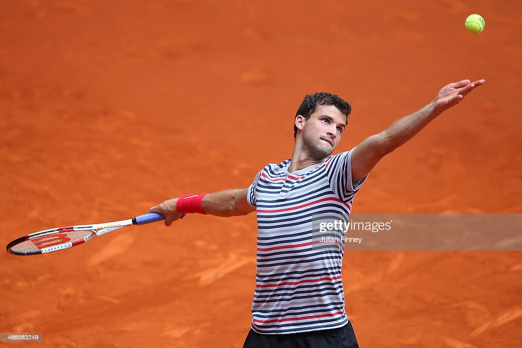 <a gi-track='captionPersonalityLinkClicked' href=/galleries/search?phrase=Grigor+Dimitrov&family=editorial&specificpeople=4332557 ng-click='$event.stopPropagation()'>Grigor Dimitrov</a> of Bulgaria in action against Marius Copil of Romania during day five of the Mutua Madrid Open tennis tournament at the Caja Magica on May 7, 2014 in Madrid, Spain.
