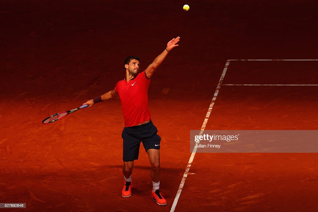 <a gi-track='captionPersonalityLinkClicked' href=/galleries/search?phrase=Grigor+Dimitrov&family=editorial&specificpeople=4332557 ng-click='$event.stopPropagation()'>Grigor Dimitrov</a> of Bulgaria in action against Pablo Carreno Busta of Spain during day four of the Mutua Madrid Open tennis tournament at the Caja Magica on May 03, 2016 in Madrid, Spain.