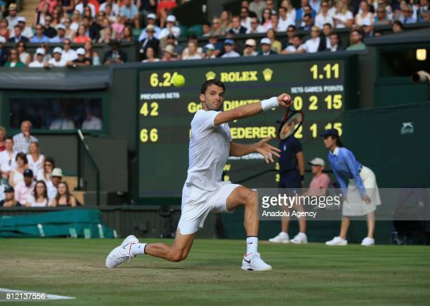 Grigor Dimitrov of Bulgaria in action against Roger Federer of Switzerland on day seven of the 2017 Wimbledon Championships at the All England Lawn...