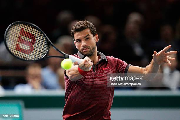 Grigor Dimitrov of Bulgaria in action Andy Murray of Great Britain during day 4 of the BNP Paribas Masters held at the at Palais Omnisports de Bercy...