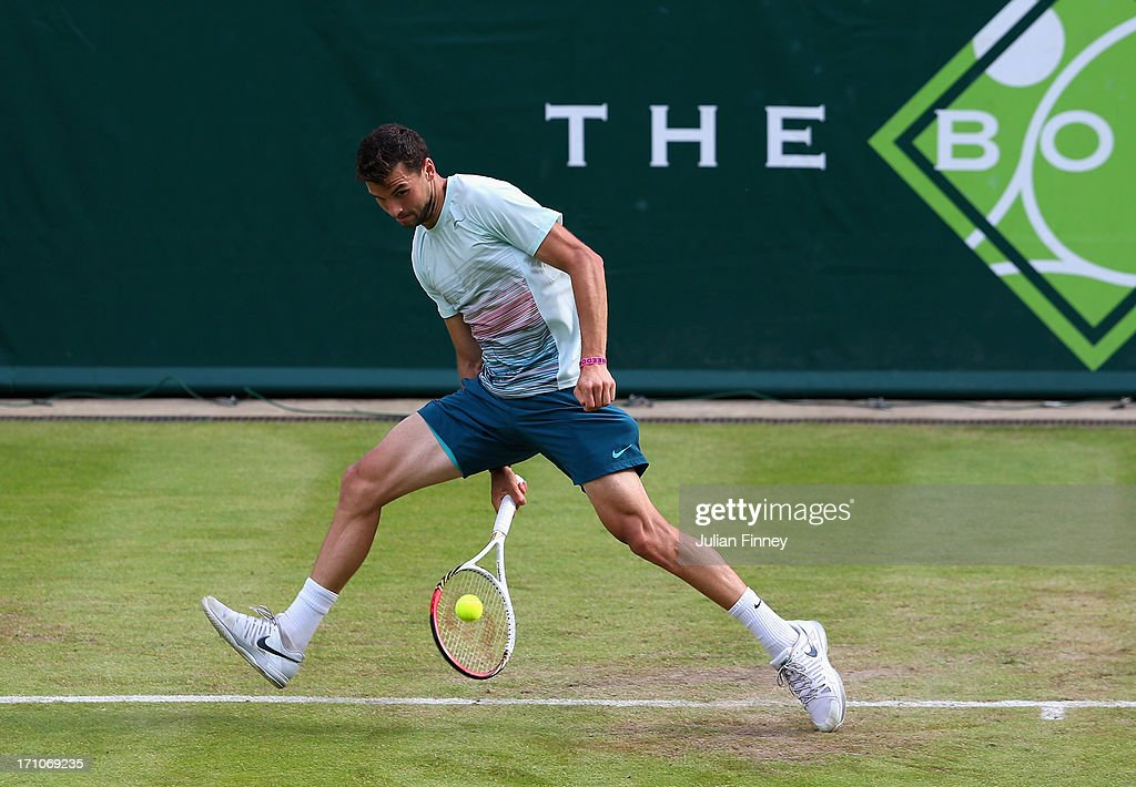 <a gi-track='captionPersonalityLinkClicked' href=/galleries/search?phrase=Grigor+Dimitrov&family=editorial&specificpeople=4332557 ng-click='$event.stopPropagation()'>Grigor Dimitrov</a> of Bulgaria in action in his match against Jerzy Janowicz of Poland during The Boodles Tennis Event at Stoke Park on June 21, 2013 in Stoke Poges, England.