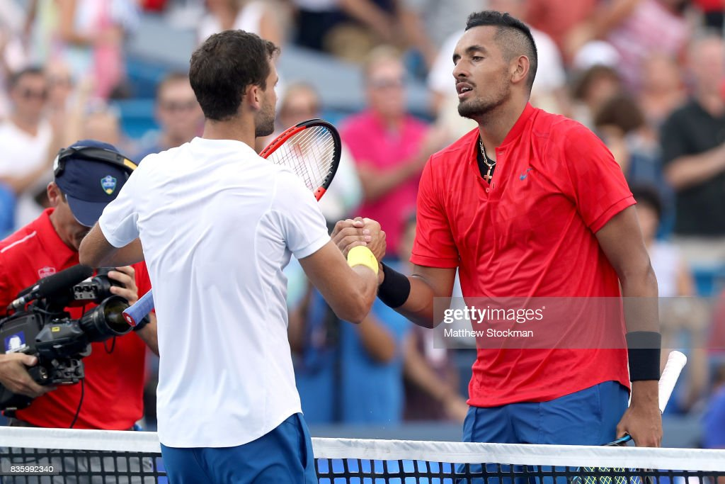Grigor Dimitrov of Bulgaria is congratulated by Nick Kyrgios of Australia after their match during the men's final on day 9 of the Western & Southern Open at the Lindner Family Tennis Center on August 20, 2017 in Mason, Ohio.