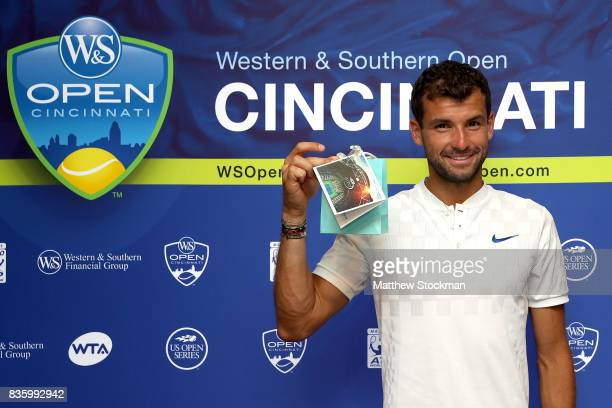Grigor Dimitrov of Bulgaria is presented a special gift from the USTA after his win over Nick Kyrgios of Australia during the men's final on day 9 of...