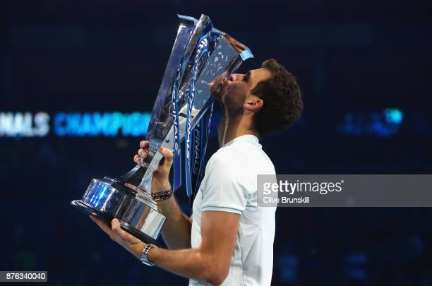 Grigor Dimitrov of Bulgaria kisses the trophy as he celebrates victory following the singles final against David Goffin of Belgium during day eight...
