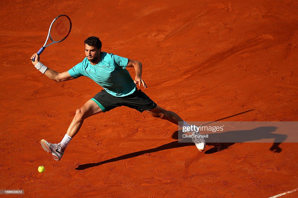 <a gi-track='captionPersonalityLinkClicked' href=/galleries/search?phrase=Grigor+Dimitrov&family=editorial&specificpeople=4332557 ng-click='$event.stopPropagation()'>Grigor Dimitrov</a> of Bulgaria leaps to play a forehand against Marcos Baghdatis of Cyprus in their first round match during day one of the Internazionali BNL d'Italia 2013 at the Foro Italico Tennis Centre on May 12, 2013 in Rome, Italy.