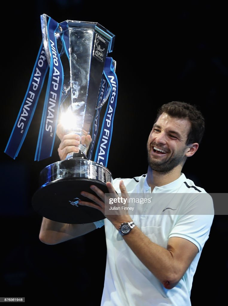 Grigor Dimitrov of Bulgaria lifts the trophy as he celebrates victory following the singles final against David Goffin of Belgium during day eight of the 2017 Nitto ATP World Tour Finals at O2 Arena on November 19, 2017 in London, England.