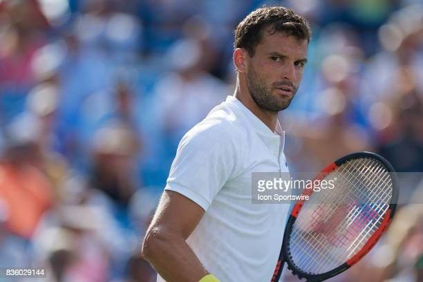 Grigor Dimitrov of Bulgaria looks at his team box after winning a point against Nick Kyrgios of Australia during the men's finals in the Western...
