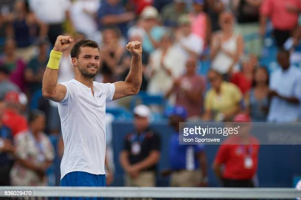 Grigor Dimitrov of Bulgaria looks at his team box after winning the match against Nick Kyrgios of Australia during the men's finals in the Western...