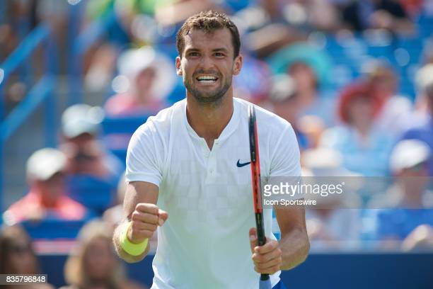 Grigor Dimitrov of Bulgaria looks at his team box and smiles after winning his semifinal match against John Isner of the United States in the Western...