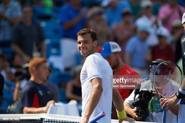 Grigor Dimitrov of Bulgaria looks back to his team box and smiles after winning his semifinal match against John Isner of the United States in the...