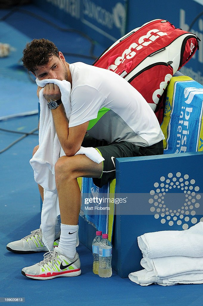 Grigor Dimitrov of Bulgaria looks dejected after his final match against Andy Murray of Great Britain on day eight of the Brisbane International at Pat Rafter Arena on January 6, 2013 in Brisbane, Australia.