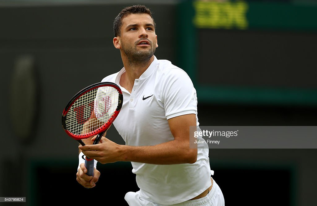 Grigor Dimitrov of Bulgaria looks on during the Men's Singles second round match against Gilles Simon of France on day four of the Wimbledon Lawn Tennis Championships at the All England Lawn Tennis and Croquet Club on June 30, 2016 in London, England.