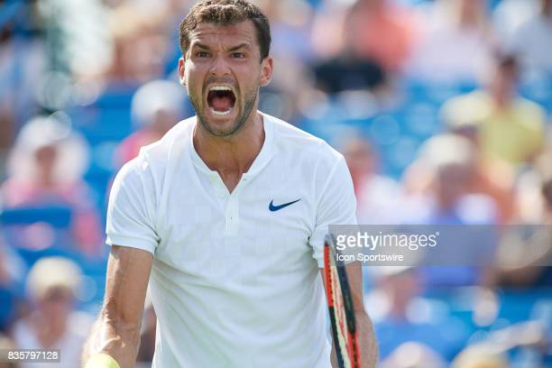 Grigor Dimitrov of Bulgaria looks to his team box and lets out a yell after winning his semifinal match against John Isner of the United States in...