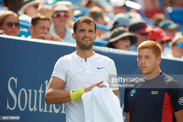 Grigor Dimitrov of Bulgaria looks to his team box during his semifinal match against John Isner of the United States in the Western Southern Open at...