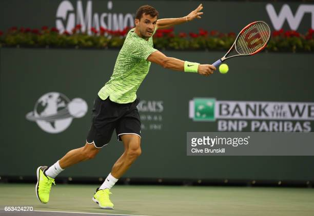 Grigor Dimitrov of Bulgaria plays a backhand against Jack Sock of the United States in their third round match during day nine of the BNP Paribas...