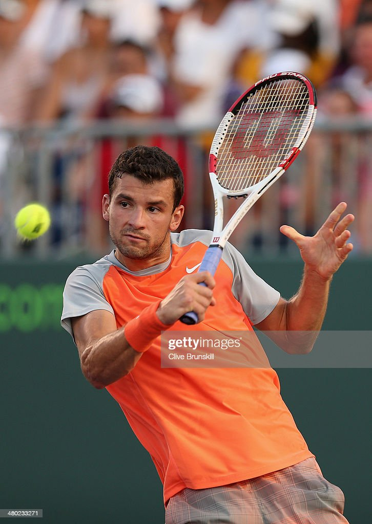 <a gi-track='captionPersonalityLinkClicked' href=/galleries/search?phrase=Grigor+Dimitrov&family=editorial&specificpeople=4332557 ng-click='$event.stopPropagation()'>Grigor Dimitrov</a> of Bulgaria plays a backhand against Kei Nishikori of Japan during their third round match during day 7 at the Sony Open at Crandon Park Tennis Center on March 23, 2014 in Key Biscayne, Florida.