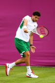 Grigor Dimitrov of Bulgaria plays a backhand against Lukasz Kubot of Poland during the Men's Singles Tennis on Day 1 of the London 2012 Olympic Games...