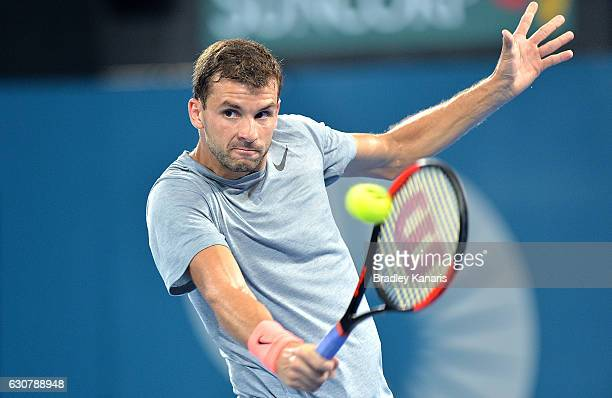 Grigor Dimitrov of Bulgaria plays a backhand against Steve Johnson of the USA on day two of the 2017 Brisbane International at Pat Rafter Arena on...