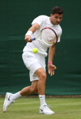 Grigor Dimitrov of Bulgaria plays a backhand during his Gentlemen's Singles first round match against Simone Bolelli of Italy on day two of the...
