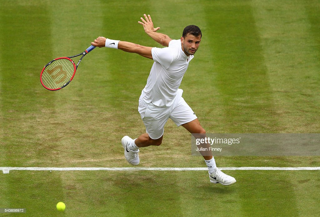 Grigor Dimitrov of Bulgaria plays a backhand during the Men's Singles second round match against Gilles Simon of France on day four of the Wimbledon Lawn Tennis Championships at the All England Lawn Tennis and Croquet Club on June 30, 2016 in London, England.