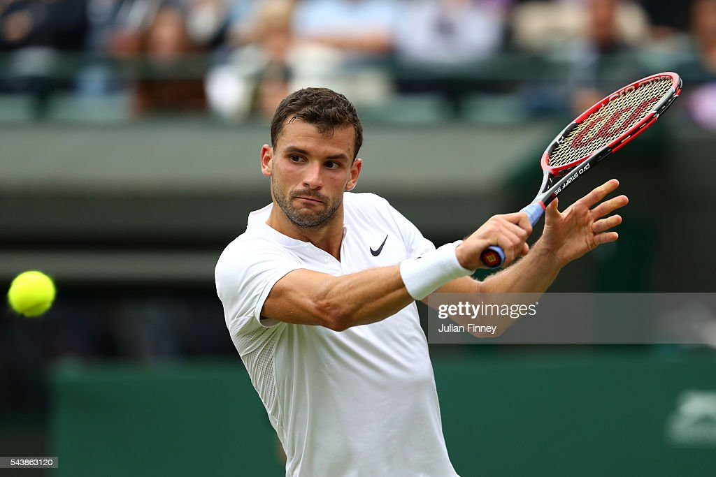 <a gi-track='captionPersonalityLinkClicked' href=/galleries/search?phrase=Grigor+Dimitrov&family=editorial&specificpeople=4332557 ng-click='$event.stopPropagation()'>Grigor Dimitrov</a> of Bulgaria plays a backhand during the Men's Singles second round match against Gilles Simon of France on day four of the Wimbledon Lawn Tennis Championships at the All England Lawn Tennis and Croquet Club on June 30, 2016 in London, England.