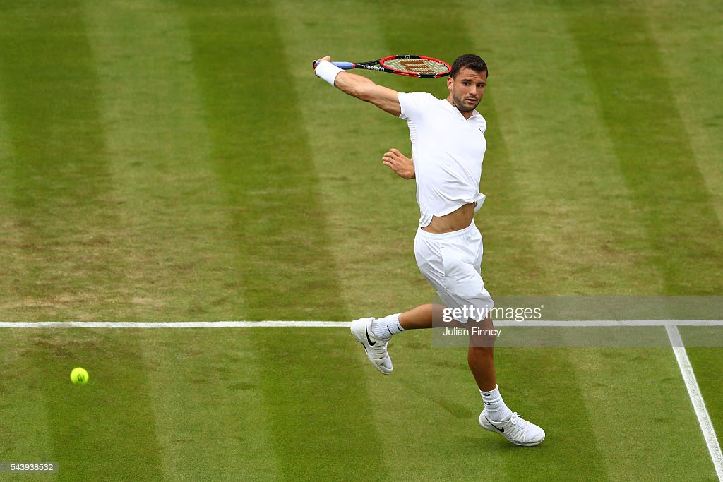 <a gi-track='captionPersonalityLinkClicked' href=/galleries/search?phrase=Grigor+Dimitrov&family=editorial&specificpeople=4332557 ng-click='$event.stopPropagation()'>Grigor Dimitrov</a> of Bulgaria plays a backhand during the Men's Singles first round match against Gilles Simon of France on day four of the Wimbledon Lawn Tennis Championships at the All England Lawn Tennis and Croquet Club on June 30, 2016 in London, England.