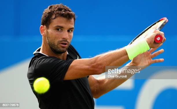 Grigor Dimitrov of Bulgaria plays a backhand during the mens singles quarter final match against Daniil Medvedev of Russia on day five of the 2017...