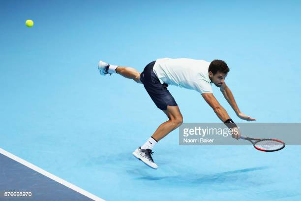 Grigor Dimitrov of Bulgaria plays a backhand during the singles final against David Goffin of Belgium during day eight of the 2017 Nitto ATP World...