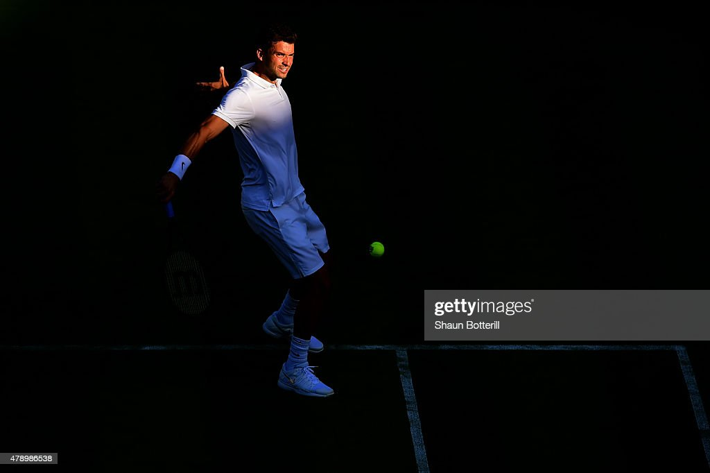 Grigor Dimitrov of Bulgaria plays a backhand in his Gentlemens Singles first round match against Federico Delbonis of Argentina during day one of the Wimbledon Lawn Tennis Championships at the All England Lawn Tennis and Croquet Club on June 29, 2015 in London, England.