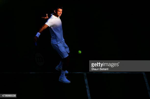 Grigor Dimitrov of Bulgaria plays a backhand in his Gentlemens Singles first round match against Federico Delbonis of Argentina during day one of the...