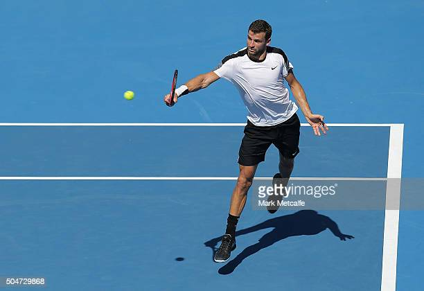 Grigor Dimitrov of Bulgaria plays a backhand in his match against Pablo Cuevas of Uruguay during day four of the Sydney International at Sydney...