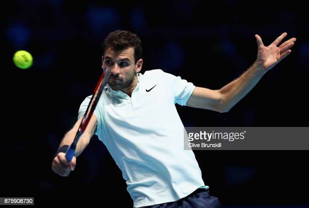 Grigor Dimitrov of Bulgaria plays a backhand in his semi final match against Jack Sock of the United States the Nitto ATP World Tour Finals at O2...